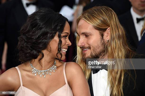 Actress Zoe Saldana and artist Marco Perego attend the 87th Annual Academy Awards at Hollywood Highland Center on February 22 2015 in Hollywood...
