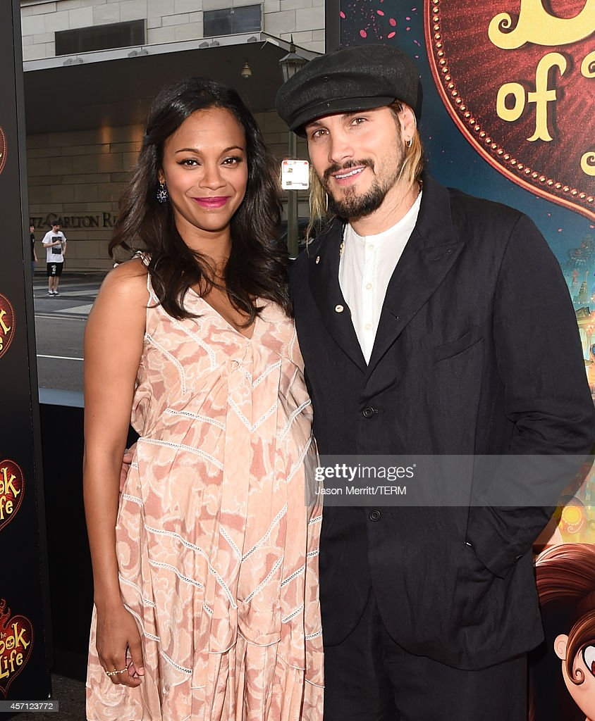 Actress Zoe Saldana and artist Marco Perego attend the Twentieth Century Fox and Reel FX Animation Studios premiere of 'The Book of Life' on Sun Oct...
