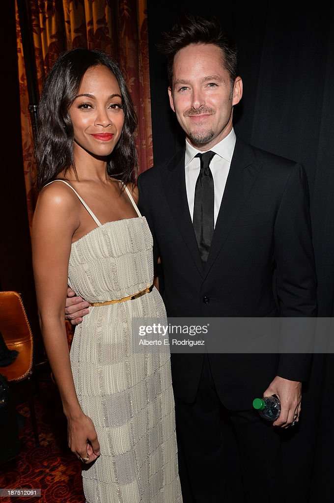 Actress <a gi-track='captionPersonalityLinkClicked' href=/galleries/search?phrase=Zoe+Saldana&family=editorial&specificpeople=542691 ng-click='$event.stopPropagation()'>Zoe Saldana</a> and director Scott Cooper attend the screening of 'Out of the Furnace' during AFI FEST 2013 presented by Audi at TCL Chinese Theatre on November 9, 2013 in Hollywood, California.