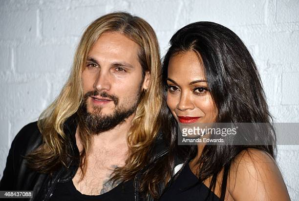 Actress Zoe Saldana and her husband Marco Perego arrive at the launch of Samsung's Galaxy S 6 and Galaxy S 6 Edge at Quixote Studios on April 2 2015...