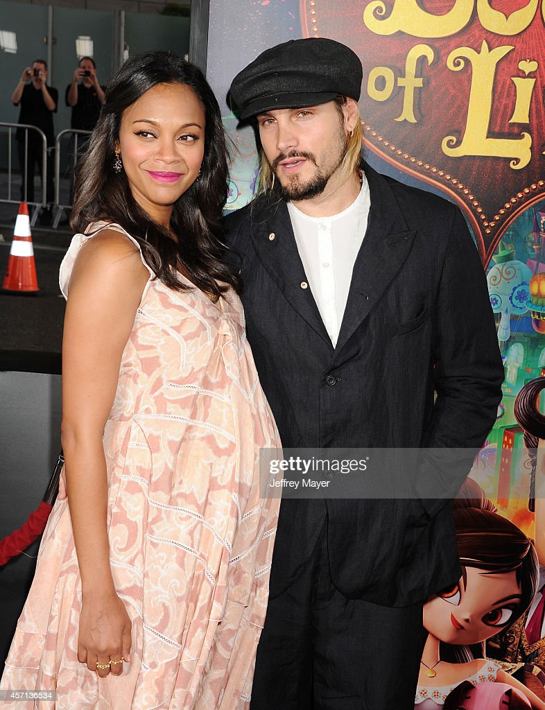 Actress Zoe Saldana and husband Marco Perego attend 'The Book Of Life' Los Angeles premiere at Regal 14 at LA Live Downtown on October 12 2014 in Los...