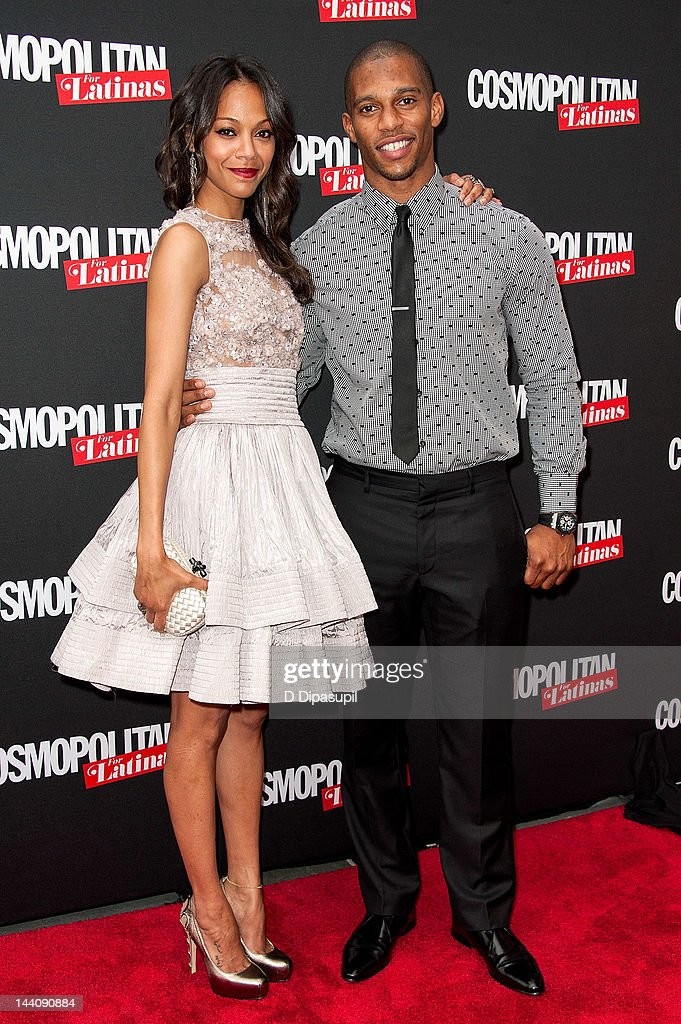 Actress <a gi-track='captionPersonalityLinkClicked' href=/galleries/search?phrase=Zoe+Saldana&family=editorial&specificpeople=542691 ng-click='$event.stopPropagation()'>Zoe Saldana</a> (L) and NFL player <a gi-track='captionPersonalityLinkClicked' href=/galleries/search?phrase=Victor+Cruz+-+American+Football+Player&family=editorial&specificpeople=8736842 ng-click='$event.stopPropagation()'>Victor Cruz</a> attend the Cosmopolitan For Latina's Premiere Issue Party at Press Lounge at Ink48 on May 9, 2012 in New York City.
