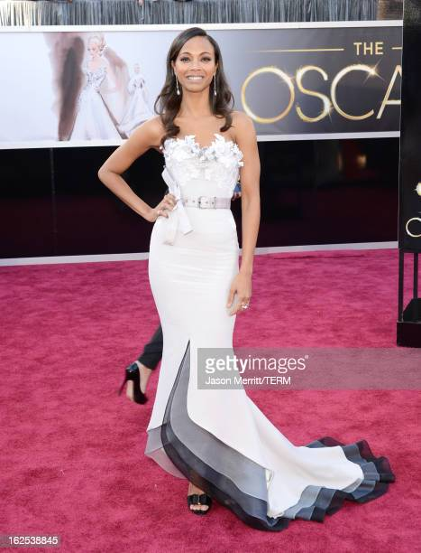 Actress Zoe Saldana arrives at the Oscars at Hollywood Highland Center on February 24 2013 in Hollywood California