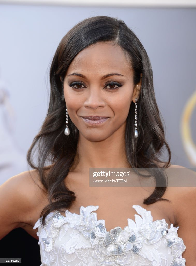 Actress <a gi-track='captionPersonalityLinkClicked' href=/galleries/search?phrase=Zoe+Saldana&family=editorial&specificpeople=542691 ng-click='$event.stopPropagation()'>Zoe Saldana</a> arrives at the Oscars at Hollywood & Highland Center on February 24, 2013 in Hollywood, California.