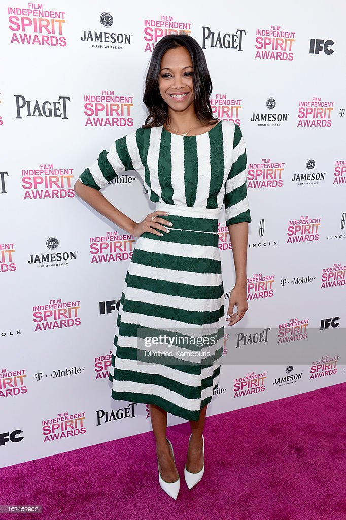 Actress <a gi-track='captionPersonalityLinkClicked' href=/galleries/search?phrase=Zoe+Saldana&family=editorial&specificpeople=542691 ng-click='$event.stopPropagation()'>Zoe Saldana</a> arrives with Jameson prior to the 2013 Film Independent Spirit Awards at Santa Monica Beach on February 23, 2013 in Santa Monica, California.