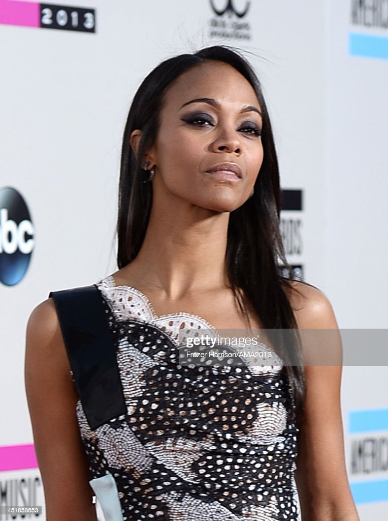 Actress <a gi-track='captionPersonalityLinkClicked' href=/galleries/search?phrase=Zoe+Saldana&family=editorial&specificpeople=542691 ng-click='$event.stopPropagation()'>Zoe Saldana</a> attends the 2013 American Music Awards at Nokia Theatre L.A. Live on November 24, 2013 in Los Angeles, California.