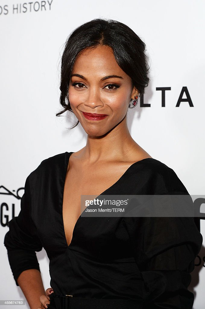 Actress Zoe Saldana attends the 2013 amfAR Inspiration Gala Los Angeles at Milk Studios on December 12, 2013 in Los Angeles, California.