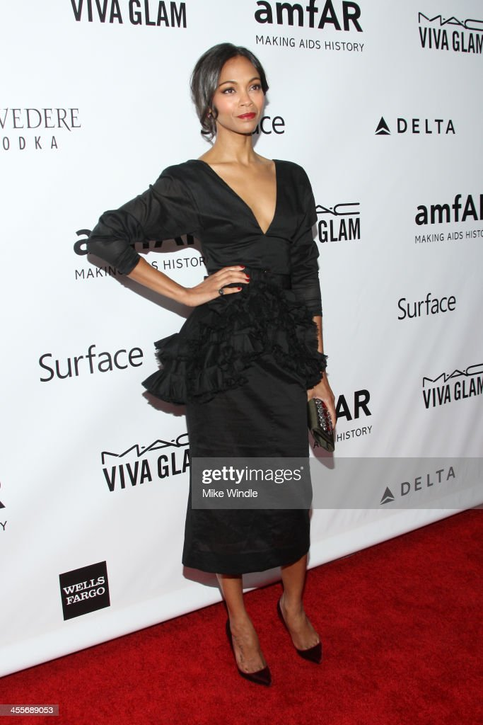 Actress <a gi-track='captionPersonalityLinkClicked' href=/galleries/search?phrase=Zoe+Saldana&family=editorial&specificpeople=542691 ng-click='$event.stopPropagation()'>Zoe Saldana</a> attends the 2013 amfAR Inspiration Gala Los Angeles at Milk Studios on December 12, 2013 in Los Angeles, California.