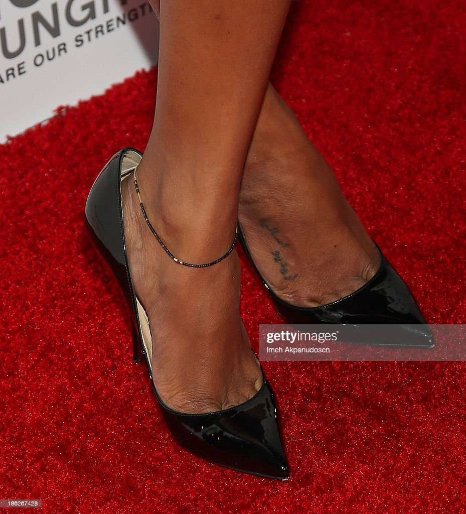 Actress Zoe Saldana (shoe detail) attends the 3rd Annual Share Our Strength No Kid Hungry Los Angeles Dinner at Ron Burkle's Green Acres Estate on October 29, 2013 in Beverly Hills, California.
