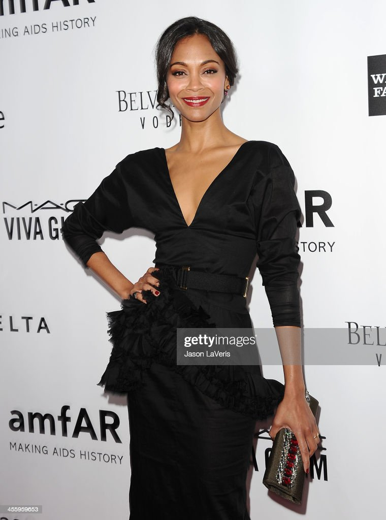 Actress <a gi-track='captionPersonalityLinkClicked' href=/galleries/search?phrase=Zoe+Saldana&family=editorial&specificpeople=542691 ng-click='$event.stopPropagation()'>Zoe Saldana</a> attends the amfAR Inspiration Gala at Milk Studios on December 12, 2013 in Hollywood, California.