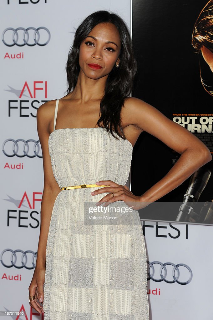 Actress Zoe Saldana attends the screening of 'Out of the Furnace' during AFI FEST 2013 presented by Audi at TCL Chinese Theatre on November 9, 2013 in Hollywood, California.