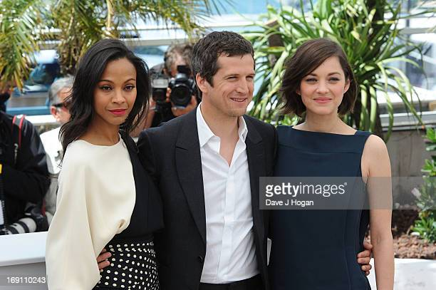 Actress Zoe Saldana director Guillaume Canet and actress Marion Cotillard attends the photocall for 'Blood Ties' at The 66th Annual Cannes Film...