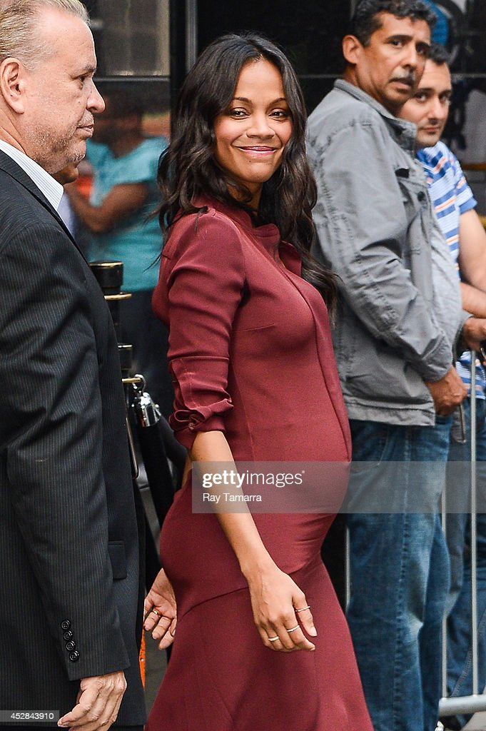 Actress <a gi-track='captionPersonalityLinkClicked' href=/galleries/search?phrase=Zoe+Saldana&family=editorial&specificpeople=542691 ng-click='$event.stopPropagation()'>Zoe Saldana</a> leaves the 'Good Morning America' taping at the ABC Times Square Studios on July 28, 2014 in New York City.