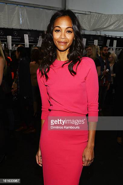 Actress Zoe Saldana poses backstage at the Michael Kors Fall 2013 fashion show during MercedesBenz Fashion Week at The Theatre at Lincoln Center on...