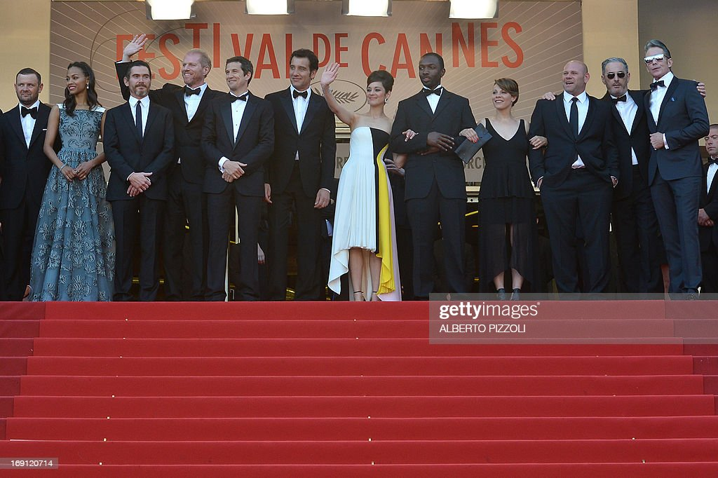 US actress Zoe Saldana, US actor Billy Crudup, US actor Noah Emmerich, French director Guillaume Canet, British actor Clive Owen, French actress Marion Cotillard, US actor Jamie Hector, US actress Lili Taylor, US actor Domenick Lombardozzi and US tattoo artist and actor Mark Mahoney pose on May 20, 2013 as they arrive for the screening of the film 'Blood Ties' presented Out of Competition at the 66th edition of the Cannes Film Festival in Cannes. Cannes, one of the world's top film festivals, opened on May 15 and will climax on May 26 with awards selected by a jury headed this year by Hollywood legend Steven Spielberg.
