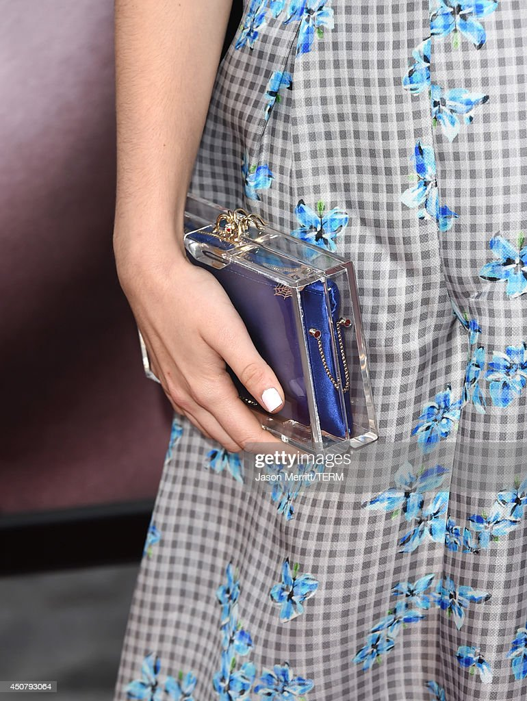 Actress Zoey Deutch (clutch detail) attends the premiere of HBO's 'True Blood' season 7 and final season at TCL Chinese Theatre on June 17, 2014 in Hollywood, California.