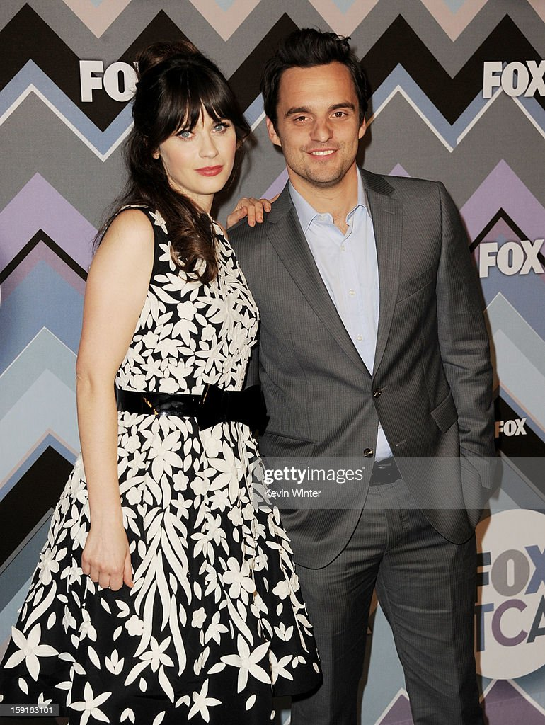 Actress <a gi-track='captionPersonalityLinkClicked' href=/galleries/search?phrase=Zooey+Deschanel&family=editorial&specificpeople=202927 ng-click='$event.stopPropagation()'>Zooey Deschanel</a> (L) and actor Jake Johnson arrive at the FOX All-Star Party at the Langham Huntington Hotel on January 8, 2013 in Pasadena, California.
