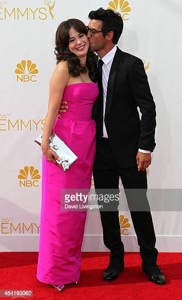 Actress Zooey Deschanel and executive producer Jacob Pechenik attend the 66th Annual Primetime Emmy Awards at the Nokia Theatre LA Live on August 25...