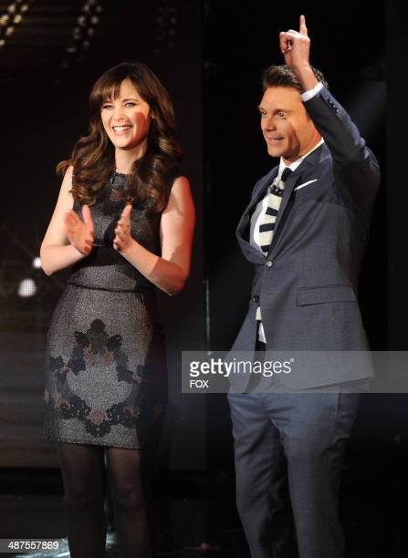 Actress Zooey Deschanel and host Ryan Seacrest onstage at FOX's 'American Idol XIII' Top 5 Live Performance Show on April 30 2014 in Hollywood...