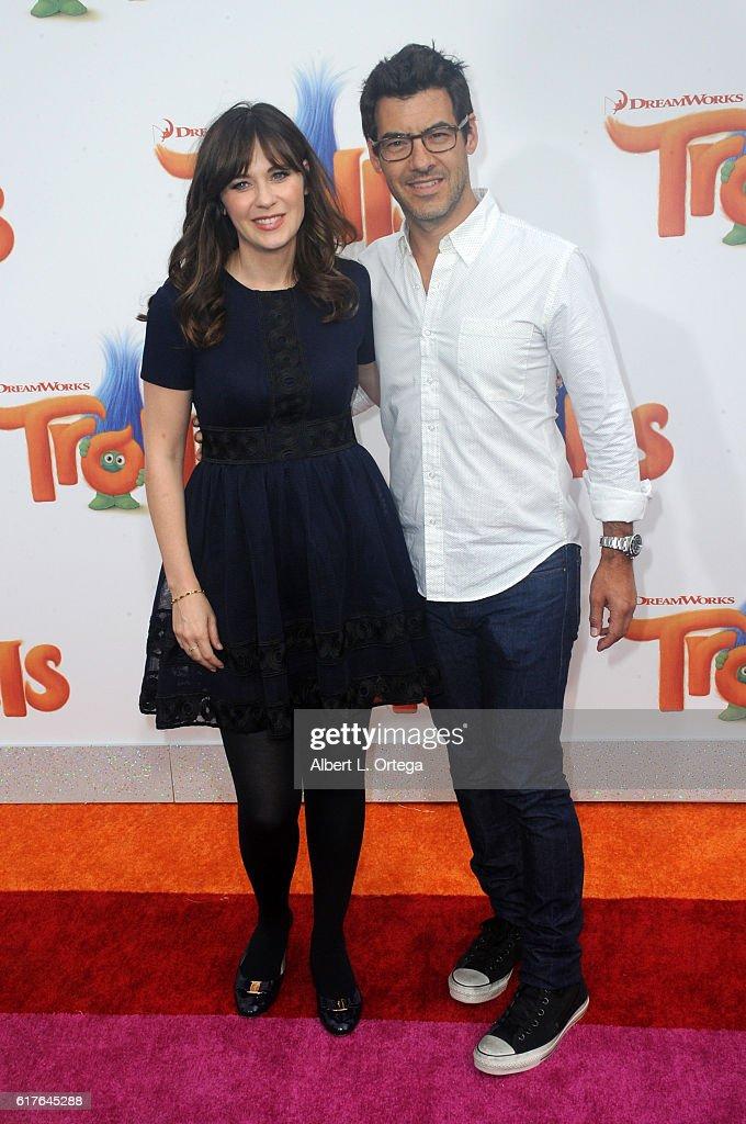 Actress Zooey Deschanel and Jacob Pechenik arrive for the premiere of 20th Century Fox's 'Trolls' held at Regency Village Theatre on October 23, 2016 in Westwood, California.
