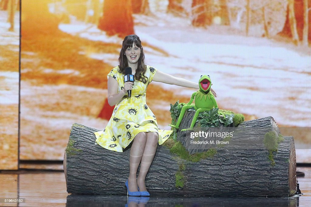Actress Zooey Deschanel (L) and Kermit the Frog speak onstage at WE Day California 2016 at The Forum on April 7, 2016 in Inglewood, California.