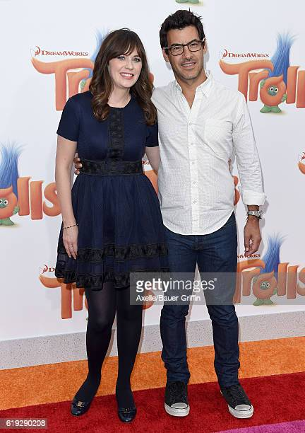 Actress Zooey Deschanel and producer Jacob Pechenik arrive at the Los Angeles premiere of 20th Century Fox's 'Trolls' at Regency Village Theatre on...