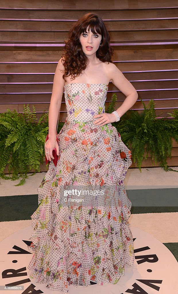 Actress Zooey Deschanel arrives at the 2014 Vanity Fair Oscar Party Hosted By Graydon Carter on March 2, 2014 in West Hollywood, California.