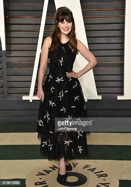 Actress Zooey Deschanel arrives at the 2016 Vanity Fair Oscar Party Hosted By Graydon Carter at Wallis Annenberg Center for the Performing Arts on...