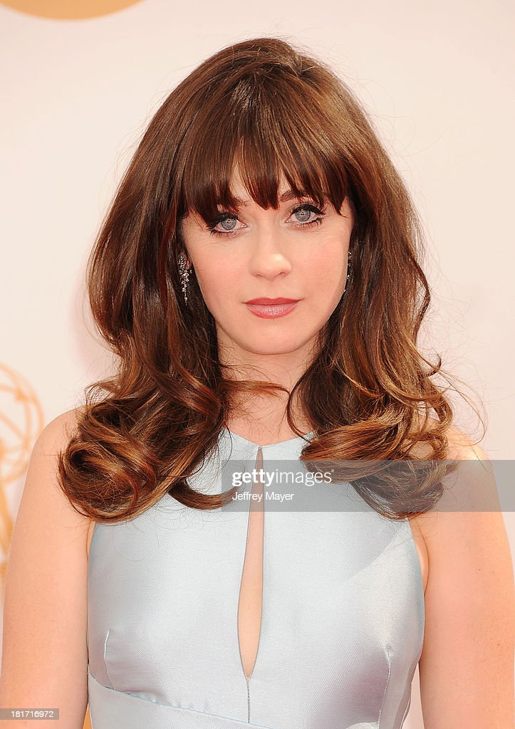 Actress Zooey Deschanel arrives at the 65th Annual Primetime Emmy Awards at Nokia Theatre LA Live on September 22 2013 in Los Angeles California
