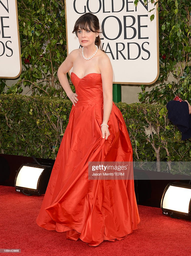 Actress Zooey Deschanel arrives at the 70th Annual Golden Globe Awards held at The Beverly Hilton Hotel on January 13, 2013 in Beverly Hills, California.