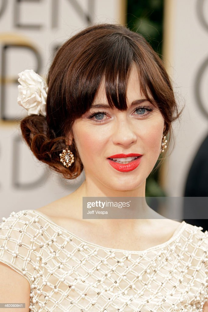 Actress Zooey Deschanel attends the 71st Annual Golden Globe Awards held at The Beverly Hilton Hotel on January 12 2014 in Beverly Hills California