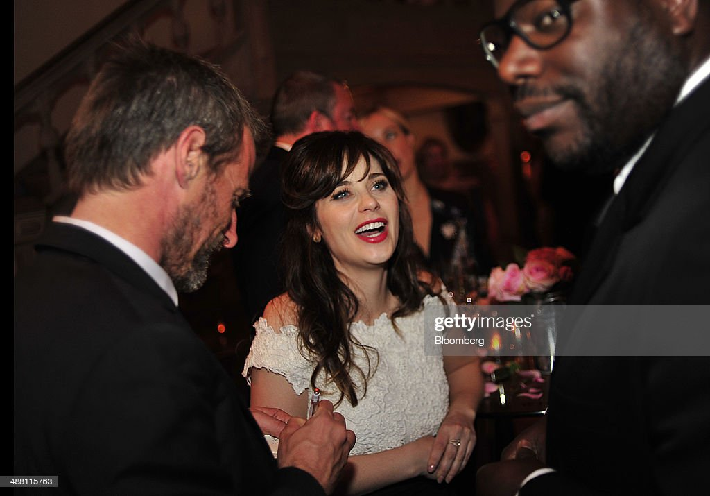 Actress <a gi-track='captionPersonalityLinkClicked' href=/galleries/search?phrase=Zooey+Deschanel&family=editorial&specificpeople=202927 ng-click='$event.stopPropagation()'>Zooey Deschanel</a>, center, attends the Bloomberg Vanity Fair White House Correspondents' Association (WHCA) dinner afterparty in Washington, D.C., U.S., on Saturday, May 3, 2014. The WHCA, celebrating its 100th anniversary, raises money for scholarships and honors the recipients of the organization's journalism awards. Photographer: Pete Marovich/Bloomberg via Getty Images