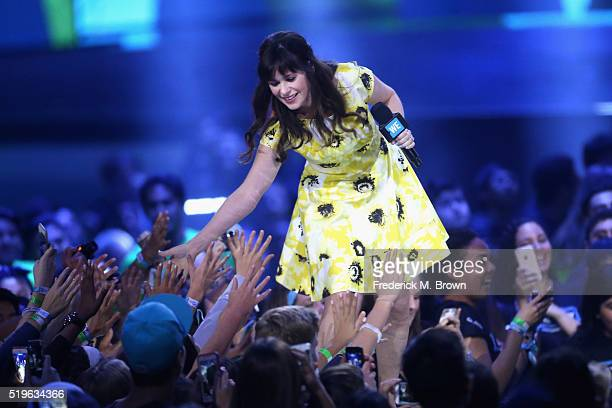 Actress Zooey Deschanel greets fans onstage at WE Day California 2016 at The Forum on April 7 2016 in Inglewood California