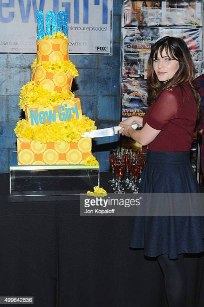 Actress Zooey Deschanel poses at FOX's 'New Girl' 100th Episode CakeCutting at Fox Studio Lot on December 2 2015 in Century City California