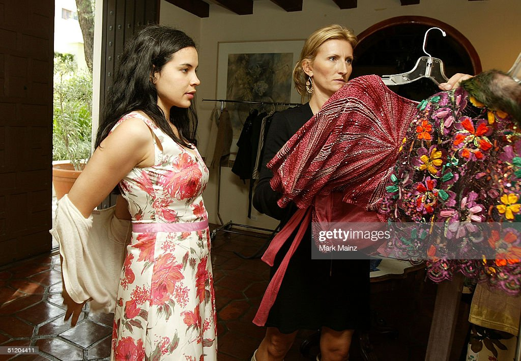 Actress Zuleikha Robinson (L) and designer Nina Morris (R) attend the 'Nina Morris Trunk Show' at Patric Reeves' home August 21, 2004 in Los Feliz, California.