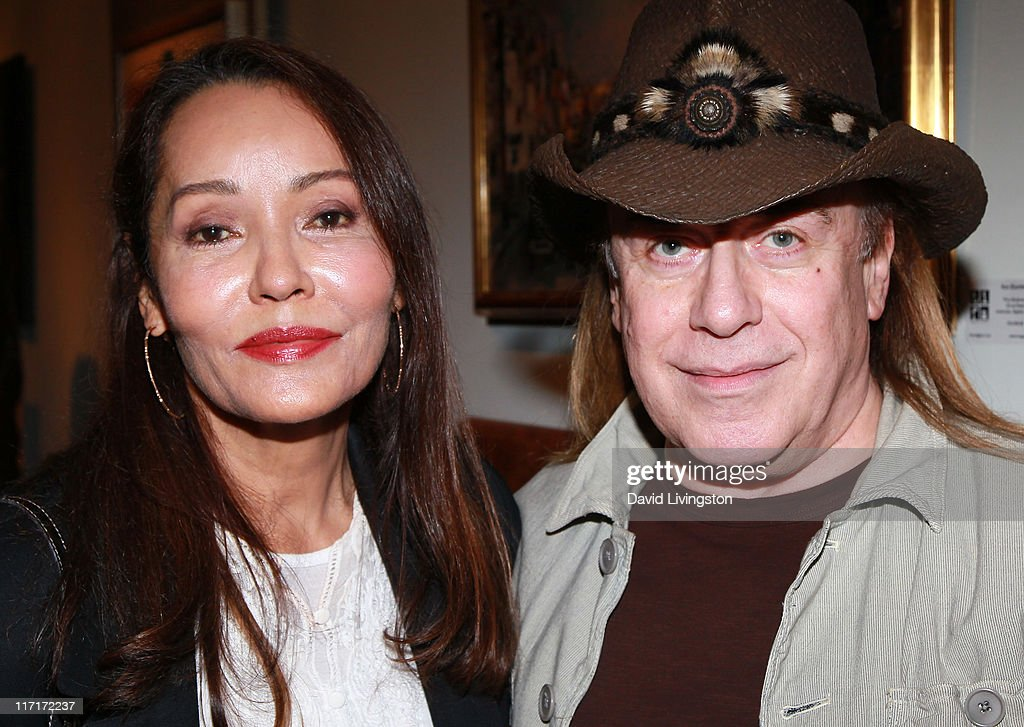 Actress/artist Barbara Carrera (L) and hairstylist Jose Eber attend ...