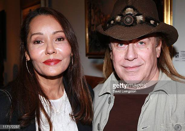 Actress/artist Barbara Carrera and hairstylist Jose Eber attend the Trigg Ison Fine Arts Gallery's new location opening on June 23 2011 in Los...