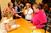 Actress/author Amy Sedaris signs an autograph for a fan at a signing of Sedaris' new book 'I Like You Hospitality Under The Influence' held at the...