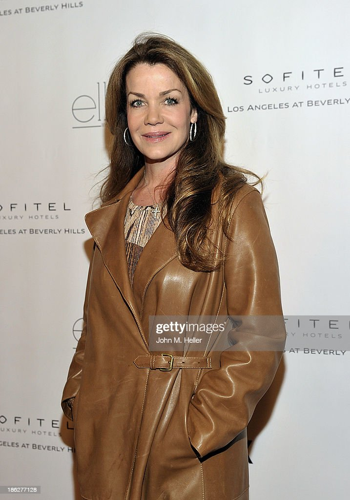 Actress/author <a gi-track='captionPersonalityLinkClicked' href=/galleries/search?phrase=Claudia+Christian&family=editorial&specificpeople=3171230 ng-click='$event.stopPropagation()'>Claudia Christian</a> attends Genlux Magazine's Hosting of Photographer Gilles Bensimon's portraits at the Sofitel Hotel on October 29, 2013 in Los Angeles, California.