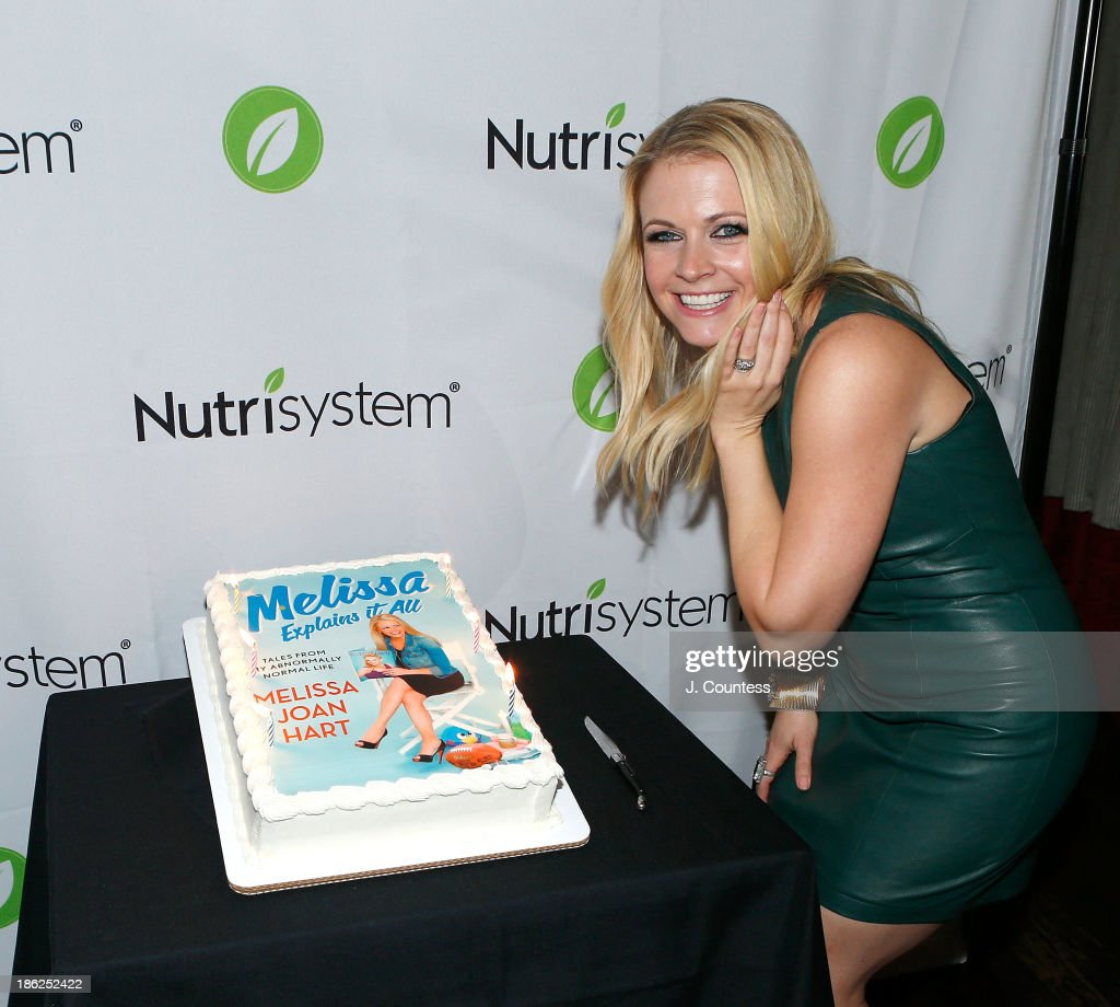 Actress/author <a gi-track='captionPersonalityLinkClicked' href=/galleries/search?phrase=Melissa+Joan+Hart&family=editorial&specificpeople=204647 ng-click='$event.stopPropagation()'>Melissa Joan Hart</a> poses for a photo at the 'Melissa Explains It All: Tales from My Abnormally Normal Life' book launch party at Monkey Bar on October 29, 2013 in New York City.