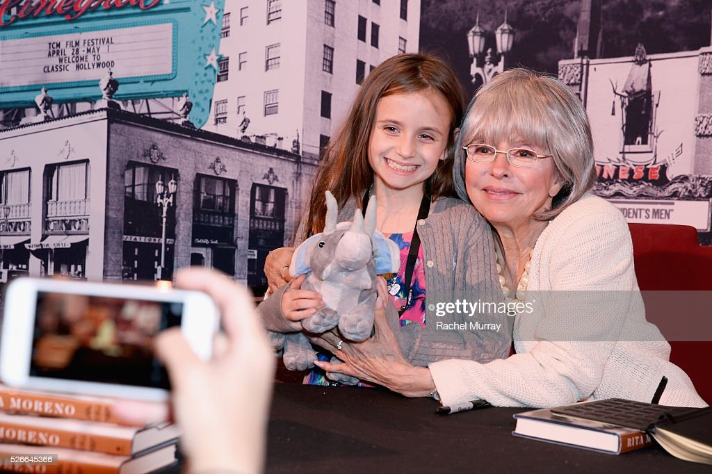 Actress/author Rita Moreno (R) attends Rita Moreno book signing during day 3 of the TCM Classic Film Festival 2016 on April 30, 2016 in Los Angeles, California. 25826_007