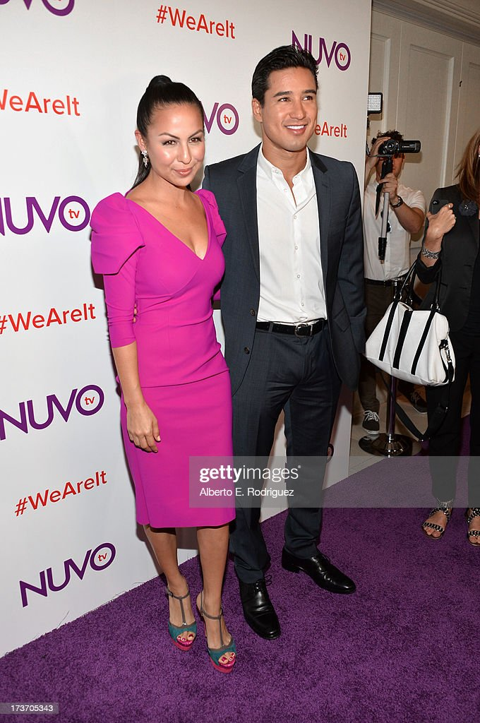 Actress/comedian Anjelah Johnson and TV personality <a gi-track='captionPersonalityLinkClicked' href=/galleries/search?phrase=Mario+Lopez&family=editorial&specificpeople=235992 ng-click='$event.stopPropagation()'>Mario Lopez</a> arrive at the NUVOtv Network Launch Party at The London West Hollywood on July 16, 2013 in West Hollywood, California.