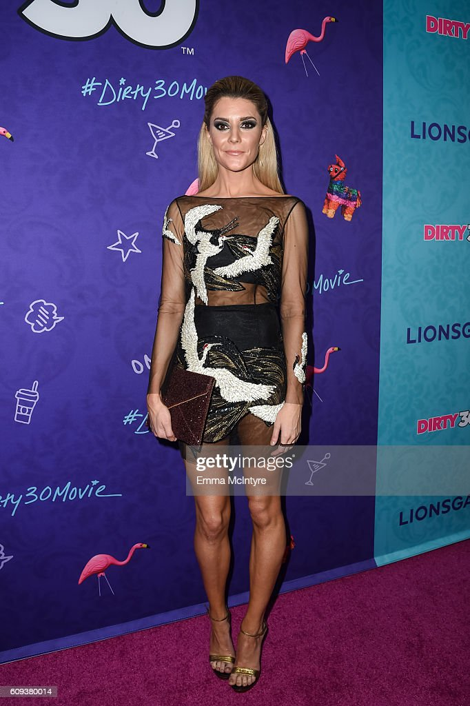 Actress/comedian Grace Helbig arrives at the premiere of Lionsgate's 'Dirty 30' at ArcLight Hollywood on September 20, 2016 in Hollywood, California.