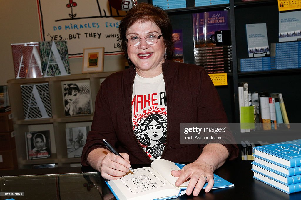 Actress/comedienne <a gi-track='captionPersonalityLinkClicked' href=/galleries/search?phrase=Julia+Sweeney&family=editorial&specificpeople=1534157 ng-click='$event.stopPropagation()'>Julia Sweeney</a> signs copies of her new book 'If It's Not One Thing, It's Your Mother' at Book Soup on April 8, 2013 in West Hollywood, California.