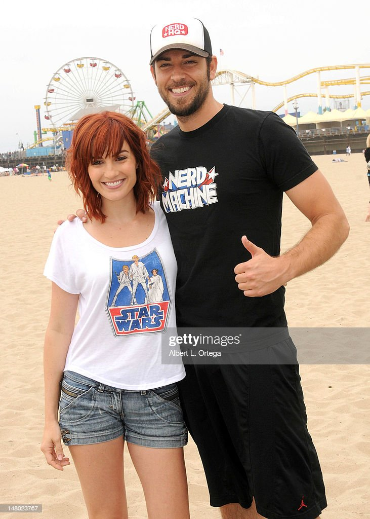 Actress/correspondent Alison Haslip and actor Zachary Levi participate in The Inaugural 'Course Of The Force' Olympic Relay Run with lightsabers to Benefit The Make-A-Wish Foundation hosted by LucasFilm, Nerdist Industries and Octagon held at The Santa Monica Pier on July 7, 2012 in Santa Monica, California.