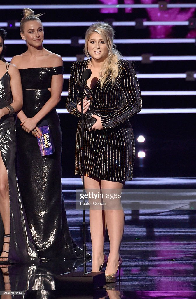 Actress/dancer Julianne Hough (L) listens as recording artist Meghan Trainor accepts the Favorite Album award for 'Title' onstage during the People's Choice Awards 2016 at Microsoft Theater on January 6, 2016 in Los Angeles, California.