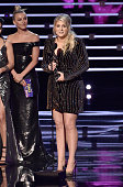 Actress/dancer Julianne Hough listens as recording artist Meghan Trainor accepts the Favorite Album award for 'Title' onstage during the People's...