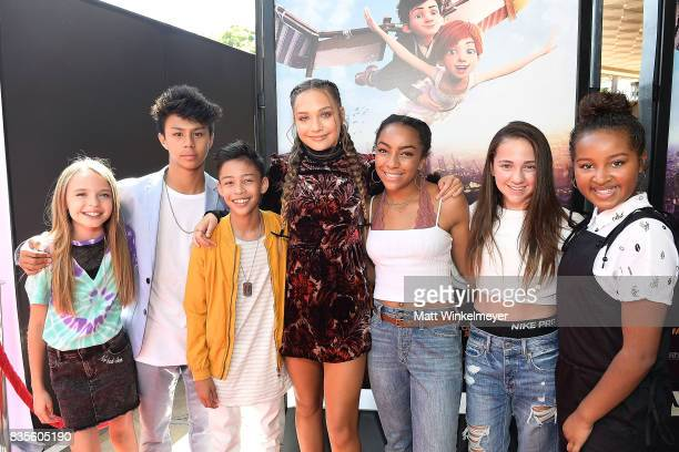 Actress/dancer Maddie Ziegler poses for a photo with friends at the Weinstein Company's 'LEAP' at The Grove on August 19 2017 in Los Angeles...