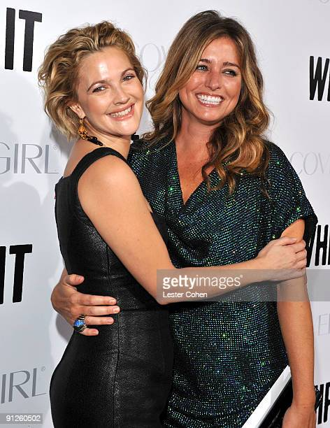 Actress/director Drew Barrymore and executive producer Nancy Juvonen arrive on the red carpet at the Los Angeles premiere of 'Whip It' at the...