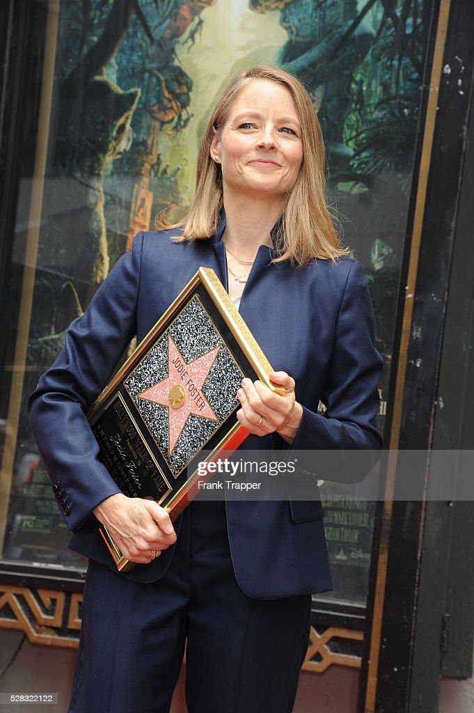 Actress/director <a gi-track='captionPersonalityLinkClicked' href=/galleries/search?phrase=Jodie+Foster&family=editorial&specificpeople=204488 ng-click='$event.stopPropagation()'>Jodie Foster</a> attends the ceremony that honored her with a Star on The Hollywood Walk of Fame in front of TCL Chinese Theater on May 4, 2016 in Hollywood, California. (Photo by Frank Trapper/Corbis via Getty Images).